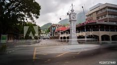Stock Video of A static timelaspe of the famous/iconic Victoria clock tower in the capital of Seychelles on the island Mahé during peak traffic, mid day time. at Adobe Stock City Scene, Day And Time, Seychelles, Stock Video, High Quality Images, Stock Footage, South Africa, Adobe, Tower