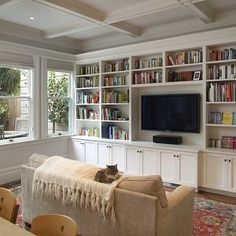 Gast Architects - living rooms - coffered ceiling, TV, white, built-ins, cabinets, red, blue, Oriental, rug, sand, beige, microfiber, sofa, ivory, throw, gray, walls, built-in cabinets, built-ins, living room built-ins, white built-ins, white built-in cabinets, built-in bookcase, living room bookcase, built-in media center, built-in media cabinet, built-in tv cabinet, built-in tv center, built-in entertainment center, floor to ceiling built-ins, floor to ceiling built in cabinets, floor to c...