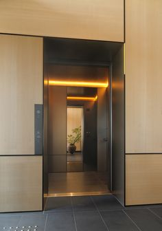 Studios Architecture, Interior Architecture, Elevator Lobby Design, New York Buildings, Dark Ceiling, Lift Design, Building Signs, Travertine Floors, Wood Cladding