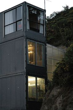 Shipping Container house Wellington New Zealand - home also extends into the hillside