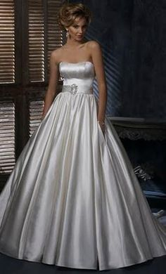 Maggie Sottero Dawn: buy this dress for a fraction of the salon price on PreOwnedWeddingDresses.com