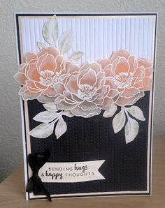 handmade card ... black and white with peach ... parchment flowers ... embossed in white and shaded with texturing ...