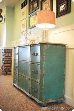 I love this teal antiqued piece.  I need to do this on a piece of my furniture.