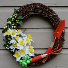 Grapevine wreath of yellow and white daffodils, orange shovel and rake, spring berries 21' inch  Nannysfrontroom on Etsy