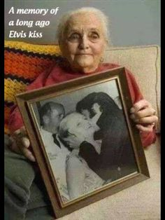In this 2008 photo, Nancy Anderson, then 89, a former reporter and West Coast editor of Photoplay magazine, shows a photograph of her receiving a kiss from Elvis Presley.