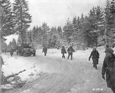 January Troops of the Airborne Division move up toward the front over snow covered roads near Houffalize, Belgium. SC photo, Pvt George H. Ardennes, Paratrooper, Division, World War Two, Change The World, First Photo, Troops, Wwii, Vietnam