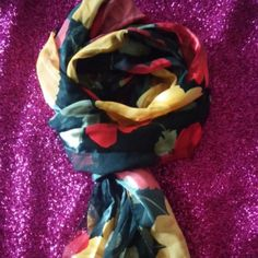 "Silky Floral Scarf Beautiful Silky Floral Scarf with Red and Yellodw Roses throughout. It is ""striped"" with  panels of solid and sheer fabric. This will be a striking addition to your wardrobe that is sure to get you lots of compliments. 100% polyester. Accessories Scarves & Wraps"