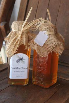 Gambier Gold Wildflower Get rid of the hessian. Really like the screen printed bottle in white. Honey Packaging, Tea Packaging, Food Packaging Design, Packaging Ideas, Honey Shop, Milk And Honey, Honey Bottles, Honey Logo, Honey Label