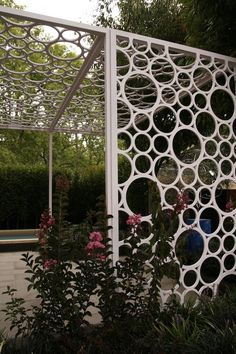 Garden screens | GardenDrum -Try this with PVC pipe cut into disks.
