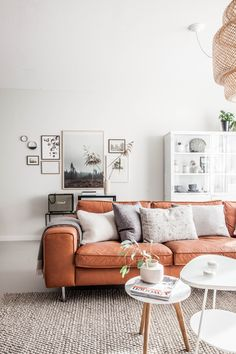 Light living room with tan leather sofa