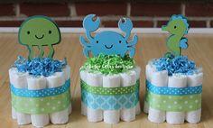 SET OF 6 - Under the Sea Diaper Cake, Boy Gender Neutral Baby Shower, Aqua, Teal, Green, Baby Shower Centerpiece, Under the Sea Baby Shower by BabeeCakesBoutique on Etsy https://www.etsy.com/listing/246118530/set-of-6-under-the-sea-diaper-cake-boy