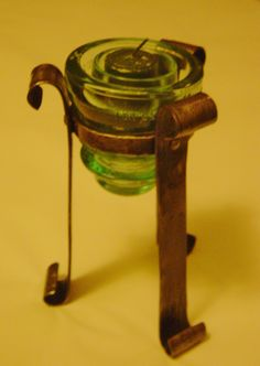 forged candle holder using old glass insulator. 02 / 2015