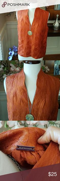 "Elie Tahari Linen/Silk Top This burnt orange and gold textured top is lovely. Excellent condition. Cool and perfect alone or under a blazer. A little hi/low action in the back. 19"" armpit to armpit by 26"" long. Elie Tahari Tops"