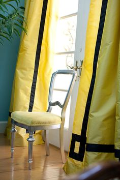 Turquoise blue & yellow color combo - Eclectic living room with turquoise blue walls paint color, yellow, silk curtains window panels with black velvet fretwork trim, silver leaf chair with yellow velvet cushion and French doors. Colourful Living Room, Eclectic Living Room, Living Room Designs, House Of Turquoise, Turquoise Walls, Yellow Curtains, Drapes Curtains, Silk Drapes, Window Coverings