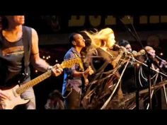 Stevie Nicks at Buffalo Chips  Sturgis 2011 almost getting blown off stage A true performer. She's not gonna let some storm stop her