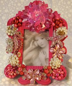 picture frame with vintage clip-on earrings and brooches