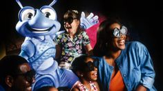 Flik, an ant character from the Disney•Pixar film 'A Bug's Life,' sits in the audience next to an excited little girl during the show, It's Tough to be a Bug!