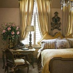 This appears to be a period bedroom out of early 20th Century Paris.