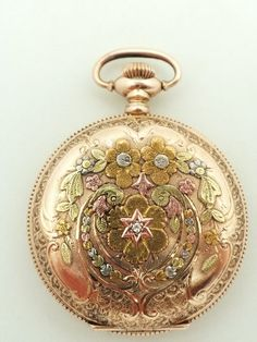 14K Elgin Pocket Watch 15 Jewel 6S $2,850.00 Antique Elgin 14K yellow gold pocket watch. The watch is beautifully hand engraved and embellished with applied lemon and rose and white gold foliate and scrolls. Both sides of the watch are highly appointed. The watch measures 1 5/8' in diameter.