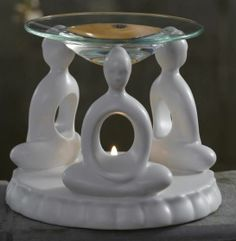"ZEN FRAGRANCE WARMER Was $30 Now $22 While Supplies Last  A trio of meditating figures casts a peaceful aura. The warmth of a tealight releases fragrance from Scent Plus® Melts or scented oil placed in the glass dish. Tealights, melts and oil are all sold separately. Matte-glazed ceramic base. 5""h, 5¾""dia.  http://www.partylite.biz/legacy/sites/stevengerard/productcatalog?page=productdetail&sku=P99007&categoryId=55268&showCrumbs=true"