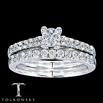Kay Tolkowsky® 14K White Gold 7/8 Carat t.w. Diamond Bridal Set. It has been nearly a century since Marcel Tolkowsky revolutionized diamond cutting with the original Ideal Cut Diamond. To this day, the Ideal Cut remains the benchmark for industry excellence and the name Tolkowsky® is synonymous with unsurpassed excellence. In this diamond engagement ring, a stunning one-third carat Tolkowsky® diamond is accompanied by a row of round diamonds and set in a band of 14K white gold. The matching…