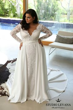 Elegant long sleeves lace fitted plus size wedding dress with a second ceremony skirt. Milena. Studio Levana
