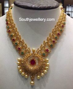 22 carat gold uncut diamond mango necklace with chandbali pendant adorned with rubies, emeralds and south sea pearl drops. Indian Wedding Jewelry, Indian Jewelry, Indian Bridal, Gold Jewellery Design, Gold Jewelry, Vintage Jewellery, Antique Jewelry, Jewelry Necklaces, Diamond Jewellery