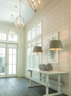 A fresh entry hall in a seaside house has great appeal. Note the wonderful wall treatment, which is casual but provides quite a bit of detail and visual interest. This type wall covering would be great in a mud room, back entry hall too Design Entrée, House Design, Wall Design, Garden Design, Coastal Living, Coastal Decor, Coastal Curtains, Coastal Rugs, Coastal Bedding