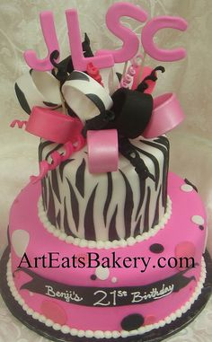 Two tier black, white and pink fondant animal print and polka dot unique creative girl's or lady's birthday cake design idea with zebra bow and monogram topper by arteatsbakery, via Flickr