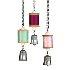 Vintage thimble and vintage wooden spool of thread hang from brass chain. Pearls inside the thimble create a gentle chime. Many colors of thread available. Each thimble and spool will be different. Gr