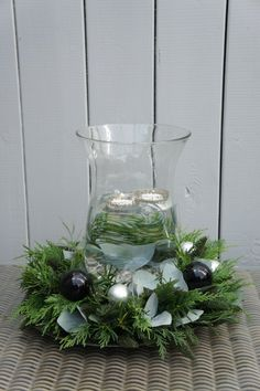 Christmas arrangement with greenery + floating candles