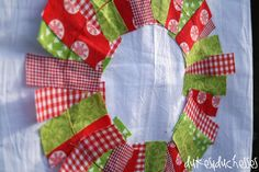 A flour sack from #WorldMarket is the perfect base for a scrap fabric wreath.  It makes a cute tea towel for Christmas! #WorldMarketTribe