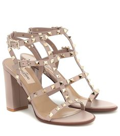 """Few shoes are more timeless than Valentino Garavani's Rockstud sandals, especially in the label's signature """"Poudre"""" beige. Sitting on a block heel, they've been crafted in Italy from calf leather that's punctuated by . Valentino Rockstud Heels, Valentino Studded Heels, Valentino Rossi, Valentino 2017, Valentino Couture, Salvatore Ferragamo, Leather Wedge Sandals, Girls Shoes, Fashion Handbags"""