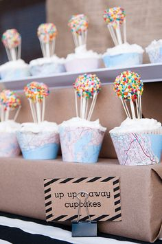 balloon cake pop-topped cupcakes? love the idea of using maps as cupcake wrappers. Source: LH Photography