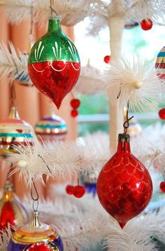 I love old glass ornaments! Had on my tree when I was a young child.