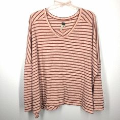Free People We The Free stripe top size large Beautiful rose blush color long sleeve top. Over sized swing top. Very clean! Free People Tops Tees - Long Sleeve
