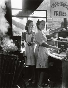 The war is over! Post World War II, a couple of French gals take part in the small pleasures of life in Willy Ronis' 1946 silver print entitled Rue Rambuteau, seen in our Important Photographs & Photobooks sale from October 19, 2010.