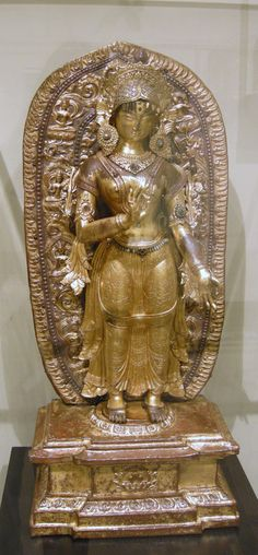 The Buddhist Goddess Tara, Repousse gilt copper set with turquoise;   Nepal, Late 17th-18th century.
