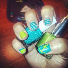 @Stefani Senecalhas been all about the bright and happy nail designs lately. We love the brighter colors on this anchor design.