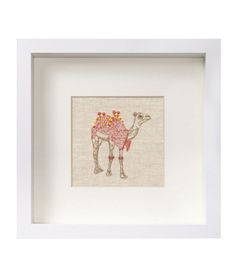 Affordable Art: Camel Embroidery A textured, embroidered treat on a neutral linen background.