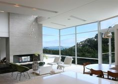 This 4 bed, 4 bath Modern is perched atop the hills overlooking Sausalito, and features floor to ceiling windows which fill the open plan lower level with natural light