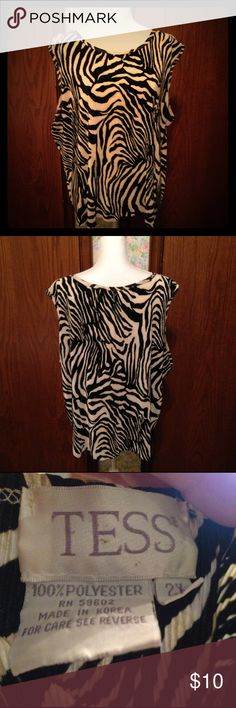 Zebra Print Blouse Sleeveless Zebra print blouse. 100% Polyester hand wash in cold water. Hang to dry or lie flat. Can be washed on delicate in cold water. Good Condition. Tess Tops Blouses
