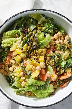 This quick and easy 25-minute vegetarian chopped power salad incorporates cilantro, lettuce, kale, carrots, bell peppers, quinoa and pepitas to create the ultimate salad recipe. Whether you're looking to make this vegetarian recipe for a quick and easy weeknight dinner or a fast lunch, it's a great choice for a salad recipe.#saladrecipes #dressingrecipes #vegetarianrecipes #veganrecipes Bean Salad, Quinoa Salad, Creamy Cilantro Dressing, Power Salad, Canned Chickpeas, Easy Weeknight Dinners, How To Cook Quinoa, Healthy Salads, Salad Recipes
