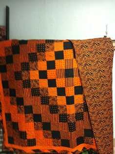 Hand pieced orange and black quilt machine by donnabyington, $325.00