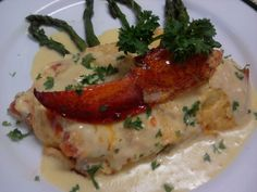 Lobster, Crab, Tomato & Cheese Omelet with Grilled Asparagus topped with Hollandaise sauce