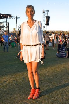 India Weber wears a Sandro dress, a Chanel bag, and Chloé boots. Coachella