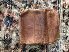 Vintage brown leather wallet pouch bag. Fold over front with snap closure, one slide in main compartment and one zippered compartment. Measures approximately 4x6 Marked Victoria leather company, made in usa Vintage condition- lots of wonderful distressing and coloring achieved