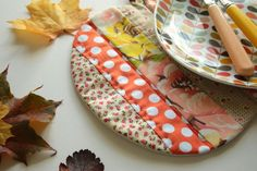 Cherry Heart: Pumpkin? A fabric placemat to add a touch of autumn to the table.