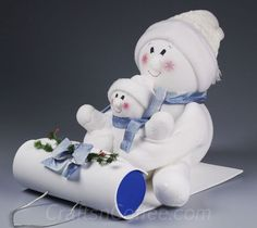 Super cute DIY! And made from Socks! Tutorial link for these Sledding Snowbuddies on CraftsnCoffee.com.