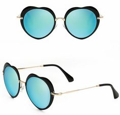 Add a dash of glamour with these matte black heart shape sunglasses. Featuring an acetate & metal frame and round mirror blue lens, they are an essential accessory. Heart Shaped Sunglasses, Round Sunglasses, Mirrored Sunglasses, Round Mirrors, Black Heart, Matte Black, Heart Shapes, Lens, Metal